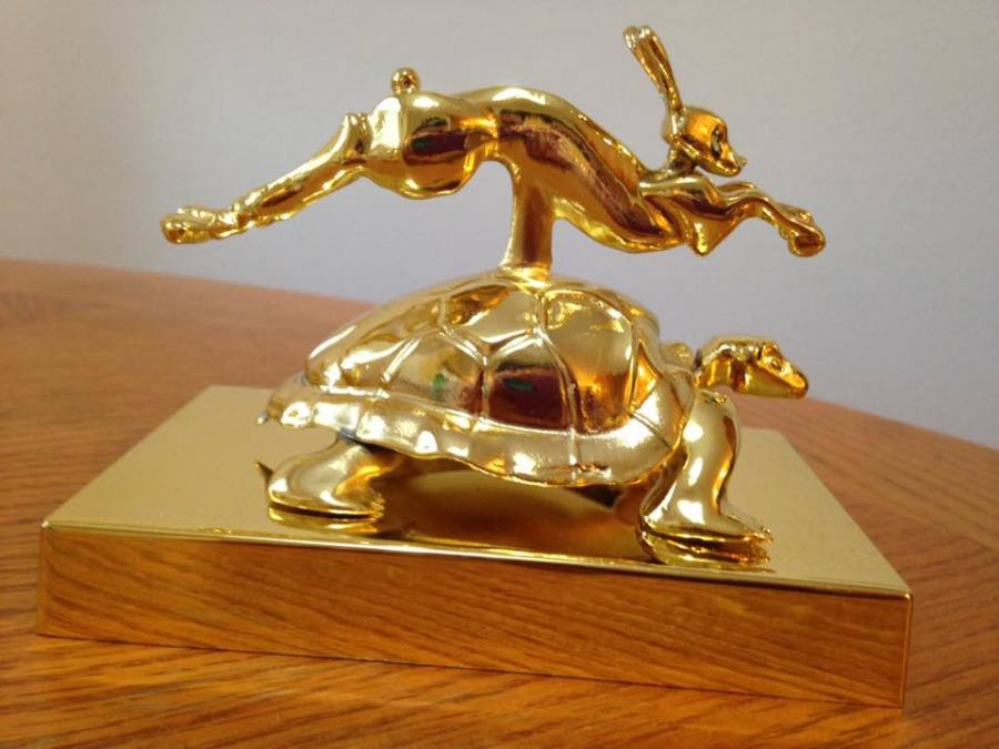 Golden Tortoise + Hare Statue: pair to division winners (co-ed, female, male teams) & to a team selected by Raffle
