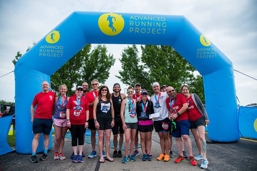 Runners and staff gather after the 2019 Crossroads 5K