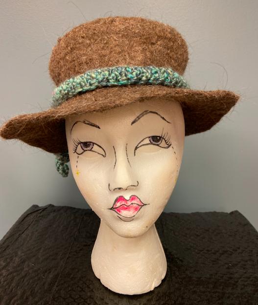 Llama wool hat on mannequin head